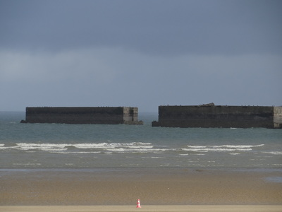 The Mulberry Harbour B cassions still present at Arromanches over 70 years after first arriving.