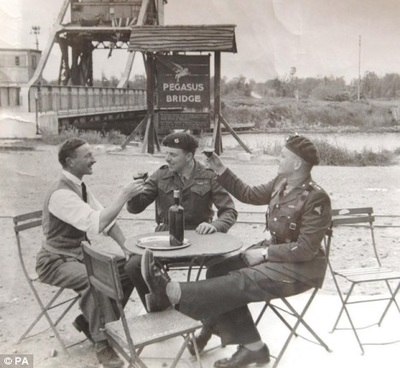 Sitting outside Cafe Gondree at Pegasus Bridge and Adrian can help you recreate this image....